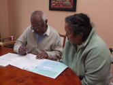 image of two people completing a form