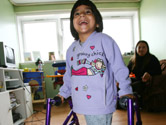 image of young girl using walking aid