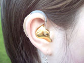 image of person wearing hearing aid