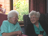 image of two ladies chatting at a day centre